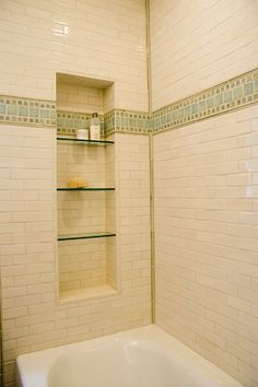 Shower niche.  Should shelves be glass (as shown) or tile/stone?  Which is easier to clean?