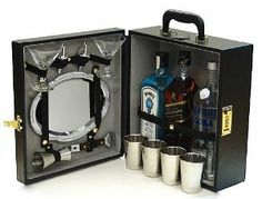 Three Bottle Bartender's Cocktail Bar Travel Bar with Tools by Trav L Bar. $69.95. Quality combination lock. Serving tray. Four metal cups. 1.5oz jigger, two speed pourers, and a bottle opener. Pair of martini glasses. All black exective style travel bar offers room for three of your favorite bottles (standard fifth sizes).  Combination lock, standard serving tray, bottle opener, martini glasses, speed pourers, and double sided jigger.   Great for yourself, groomsman gifts, or ju...