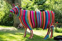 what a lot of work. yarnbombing a statue of a cow!