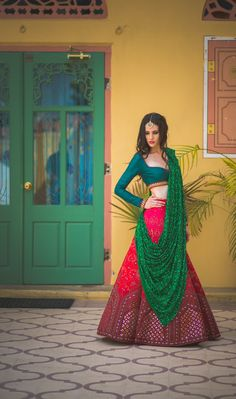 Light Lehengas - Teal and Pink Lehenga | WedMeGood | Teal Colored Full Sleeve Blouse with Pink Lehenga with Mirror Work on the Border, Green Shimmery Dupatta #wedmegood #lehenga #indianbride #indianwedding #bridal #choli