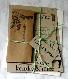 """Eco-friendly wedding invitations tied with green twine. Just pretend it doesn't say """"Kendra and Mike"""""""