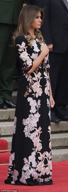 Official: Melania donned the stunning  gown, thought to be Chinese-inspired, as she met wi...