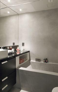 A peça, feita de alvenaria, foi revestida de cimento polimérico (NS Brazil), que se replica no piso e nas paredes.