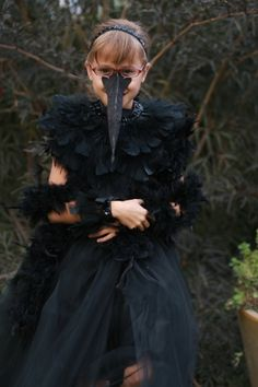 raven costume - pretty!- get more elaborate for a grown up version by adding mask with head feathers.. a la heidi klum