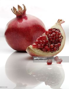 Stock Photo : Pomegranate, with slice, on white