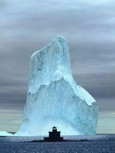 Iceberg, Witless Bay, Newfoundland, Canada Look at size of ice above water level. What could it do to the lighthouse? Newfoundland Canada, Newfoundland And Labrador, Newfoundland Icebergs, Alaska, All Nature, Amazing Nature, Gros Morne, Beautiful Places, Beautiful Pictures