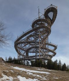 Fránek Architects' mountainside Sky Walk loops up around a giant slide (Dezeen) Sky Walk, Travel News, Amazing Architecture, Czech Republic, Places To Visit, Around The Worlds, Tower, Walking, Clouds