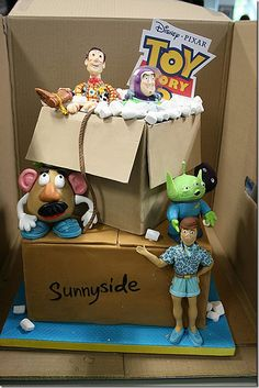 really cute toy story 3 themed cake. Love the fact that it is displayed IN a box.