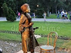 Video about Young woman trying to sell her charm at international festival of living statues in Bucharest, Romania. Video of expression, entertainment, love - 94026796 Living Statue, Bucharest Romania, International Festival, Young Women, Statues, Garden Sculpture, Entertainment, Charmed, Woman