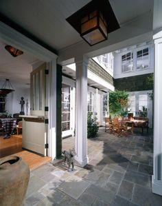 love everything...dutch door, stone floors, windows.
