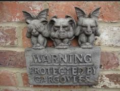 Gargoyle Protection Agency.  The latest version has another gargoyle with his hands over his 'privates' and it means…do no evil.