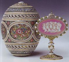 The Mosaic egg, also belonging in the Royal Collection was considered one of Faberge's most sophisticated creations. It was gifted to the Empress Alexandra by her husband, Tsar Nicholas II in 1914. However, due to the original invoice being destroyed, the exact cost of this egg is unknown. The five portraits on the 'surprise' are of OTMA and Alexei, their children.