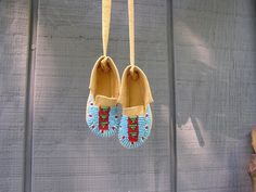 I made these leather mini dance moccasins with size 12 seed beads. They are too small for a baby but great for decoration.
