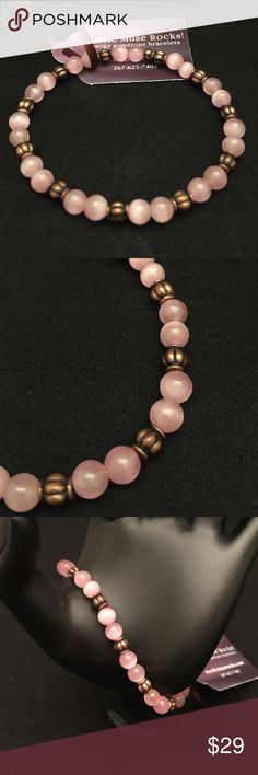 "Rose Quartz Gem Bracelet 7"" unconditional love Custom one of a kind semi precious stone Rose quartz with bronze accents bracelet on stretch cord that measures 7"". Rose Quartz represents unconditional love, opens the heart for romance and self love. This is a description not a prescription for positive energy. Handmade with positive energy! Mystic Muse Rocks Jewelry Bracelets"
