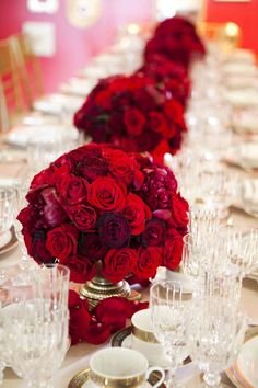 Simple red roses along a long table make a bold statement.