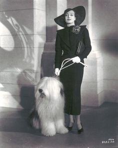 Joan Crawford in the 30s. Love her doggie friend.