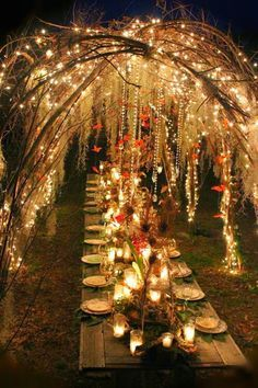 faerie party table | An enchanting evening tablescape with sparkly twinkle lights, sweeping branches, candlelight, dangling crystals and floating butterflies