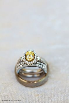Smaller sidestones add just enough sparkle to an already-magnificent canary yellow center stone.