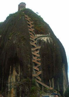 Now that's a set of stairs. 659 stairs to the top, The Guatape Rock in Colombia. I've climbed the Santa Monica Stairs MANY some stairs.this looks AWESOME! Places To Travel, Places To See, Travel Destinations, Wonderful Places, Beautiful Places, Amazing Places, Places Around The World, Around The Worlds, Take The Stairs