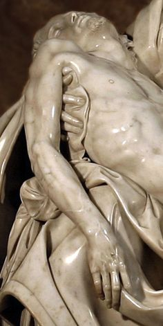 Michelangelo - Detail of the Pieta, in St. Peters Basilica in Rome