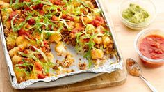 Put a fun twist on dinnertime with these potato nugget nachos loaded with all your favorite toppings.