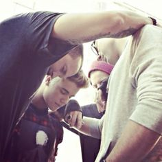 Justin Bieber prays with Hillsong NYC pastor Carl Lentz and The City Church pastor Judah Smith in this photo shared Nov. 20, 2014, on Twitte... Justin Bieber Baptism