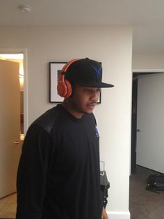 Carmelo Anthony with a custom pair of SMS Audio headphones.