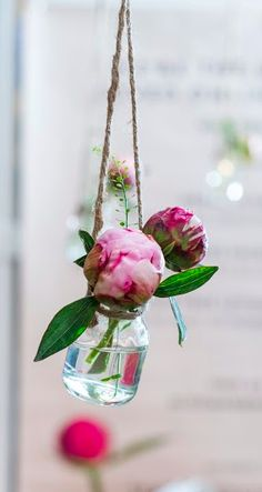 Tiny jars can make the perfect posy hanging display at a pop up shop. We used them to decorate our Peony Shop at Topshop Oxford Street.