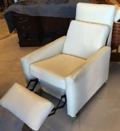 """White leather lounge chair reclines at your touch. Modern Italian design, compact size. On wheels. 27"""" x 30"""" x 28"""" tall back."""