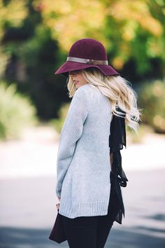 The perfect fall outfit - What to Wear on Thanksgiving | hat | sweater | black denim | boots | clutch