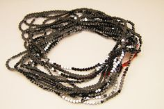 1strand  natural hematite plain heart sized 4 by 4mm by 3yes