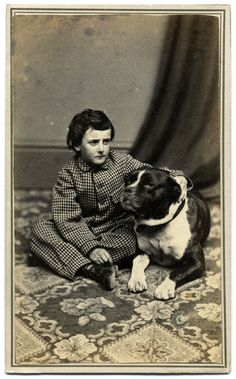 https://flic.kr/p/erMVtq | A Boy's Best Friend | <b><i>Carte de visite</i> by J.H. Crittenden of Fall River, Mass.</b> An earnest boy sits cross-legged on the floor of the photographer's studio. His left arm is draped across the shoulders of a big dog with his head turned in a submissive manner towards his young master. A collar is just visible about the dog's neck.  <i>I encourage you to use this image for educational purposes only. However, please <a ...
