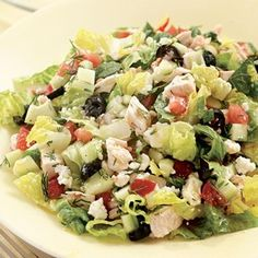 Chicken turns this Greek-inspired salad into a substantial main course. Feel free to substitute other chopped fresh vegetables, such as broccoli or bell peppers, for the tomatoes or cucumber. Use leftover chicken, store-roasted chicken or quickly poach a couple boneless, skinless chicken breasts while you prepare the rest of the salad. Serve with pita bread and hummus.