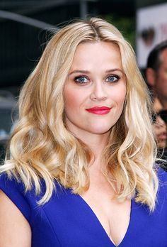 Brides.com: . Reese Witherspoon. Go big with a shimmering mauve shade above and below the eye for a pretty contrast to your pop of red. Reese's loose waves and pink cheeks are a subtle way to round out the look.