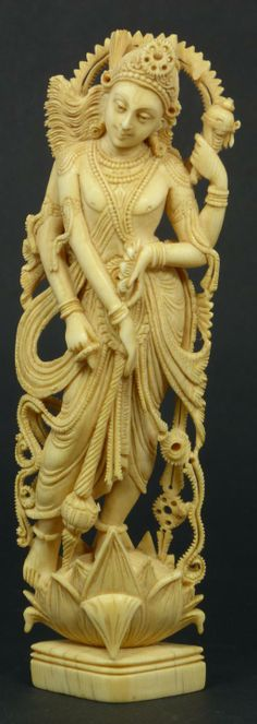 ANTIQUE HAND CARVED INDIAN IVORY FIGURE DEPICTING THE HINDU GOD KRISHNA WITH FOUR ARMS. FINELY CARVED AND FULLY RETICULATED THROUGHOUT, CIRCA 19TH CENTURY