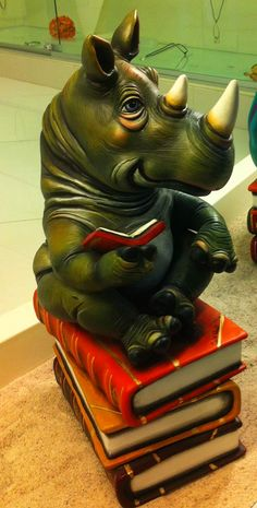 """'Rhino' - part of the collection titled """"The Book Club"""" by Carlos Albert Save The Rhino, Sculptures, Lion Sculpture, Animal Books, Illusion Art, Rhinoceros, I Love Books, Storytelling, Fantasy Art"""