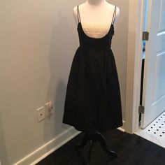 Black sundress Knee length black sundress with cream ruffle along the top. Super comfortable style with pockets! Measures 38 inches including straps. Originally from Anthropology. Tag says 2 but will easily fit a 4. Anthropologie Dresses Midi