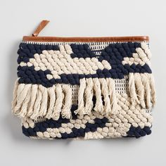Make a statement with our chunky knit navy and ivory clutch purse. It features white fringe on the body of the bag and a zipper closure to make sure your contents stay put.