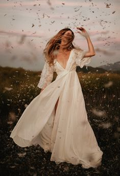 Every boho bride's dream - ethereal draping, plunging necklines, and delicate embellishments. This Dreamers & Lovers dress reminds us definitely has Free People vibes, mixed with classy elegance and sophistication.