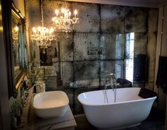 My very own mini Palace of Versailles Bathroom. With the renovation complete I am so happy with everything from the Victoria and Albert Amiata bath and basin, our bespoke marble vanity,  the concrete look tiles, Byron Bay  Antique Mirror Glass, beautiful Brodware tap-ware and the stunning Designer Chandeliers. My very own little place of magic and luxury.