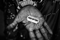 Meeri Koutaniem. Blood, Fear and Ritual: Witness to Female Circumcision in Kenya. Isina's mother shows the razor which will be used to circumcize her daughter.
