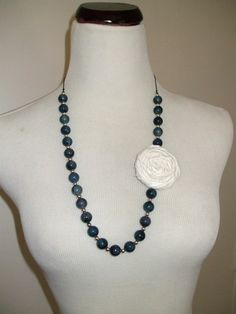 Beaded necklace with rolled fabric flower