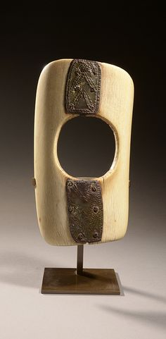 Burkina Faso | Bracelet from the Gurunsi or Lobi people; Ivory with indigenous brass repairs. H: 22 cm | Est. 500 - 600€ ~ (Apr '15)