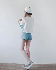 Cute summer outfit with the jersey styled top, denim cutoffs, slip-ons and a black and white snapback