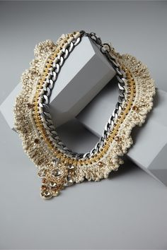 Very clever - working into a non crochet base. Now that's crocheted jewelry to wear!