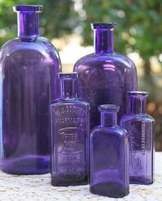 "Sun colored amethyst or ""purple glass"" bottles, to WWI. These look beautiful in a window or on a w Sun colored amethyst or ""purple glass"" bottles, to WWI. These look beautiful in a window or on a white shelf. Purple Stuff, Purple Love, All Things Purple, Purple Glass, Shades Of Purple, Cobalt Glass, The Color Purple, Purple Punch, Deep Purple"