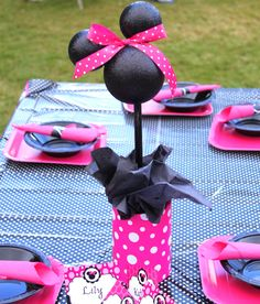 Minnie centerpieces...Paint styrofoam balls, secure ears with toothpick & hot glue, secure head into bucket with dowel rod, add bow