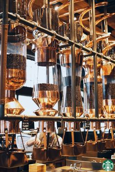 The main bar in the new Starbucks Roastery and Tasting Room in Seattle is a work of art—serving works of art.