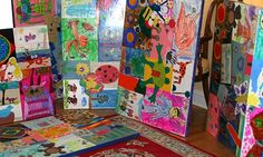 """artistically collage their original artwork -- the kind of artwork that is stored in volumes in rubbermaid bins and bags in the attic, forever -- onto handcrafted wooden art panels using a decoupage process. A 30x40"""" board typically showcases 10-18 pieces of original art."""