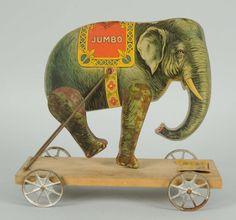 Lot# : 616 - Early Gibbs Paper on Wood Jumbo Elephant Toy.